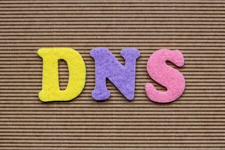 dns: DNS (Domain Name System) acronym on cardboard background
