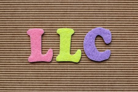 limited liability company: LLC (Limited Liability Company) acronym on cardboard background Stock Photo