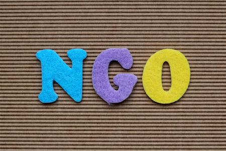 NGO (Non-Governmental Organization) acronym on cardboard background