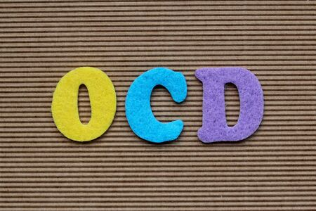 obsessive compulsive: OCD (Obsessive-compulsive disorder) acronym on cardboard background Stock Photo