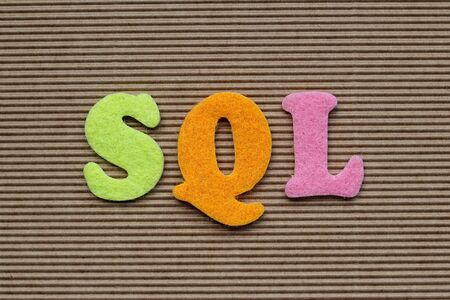 sql: SQL (Structured Query Language) acronym on cardboard background