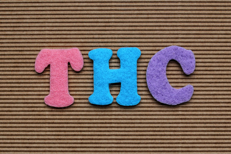 acronym: THC (Tetrahydrocannabinol) acronym on cardboard background Stock Photo