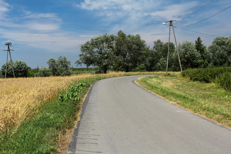 dream land: countryside landscape with road at summertime Stock Photo