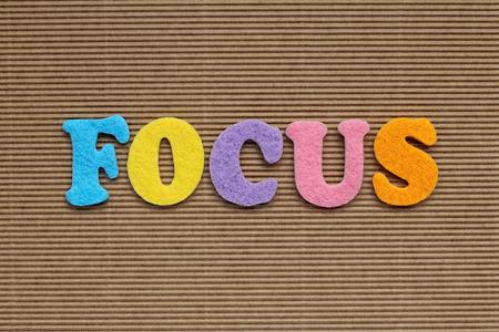 focalise: focus word on cardboard background