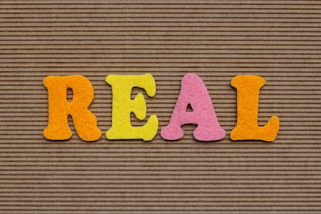 incarnate: real word on cardboardbackground Stock Photo