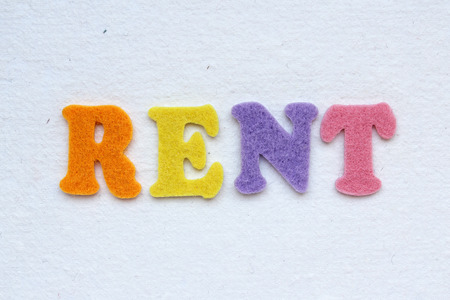 realestate: RENT text on white handmade paper texture Stock Photo
