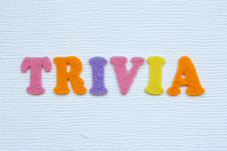 trivia word on white handmade paper texture