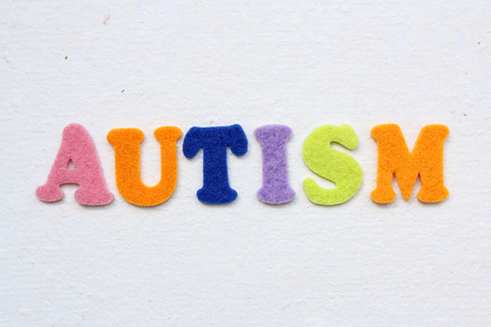 autism word on white handmade paper texture Stock Photo