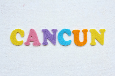 cancun: Cancun word on white handmade paper texture