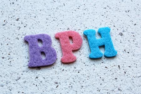 urethral: BPH (Benign Prostatic Hyperplasia) acronym on handmade paper texture Stock Photo