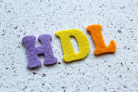 good cholesterol: HDL (high-density lipoprotein) acronym on handmade paper texture