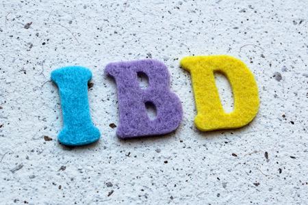 bowel: IBD (Inflammatory Bowel Disease) acronym on handmade paper texture Stock Photo