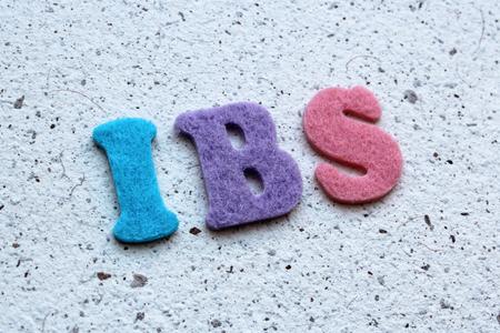 bowel: IBS (Irritable Bowel Syndrome) acronym on handmade paper texture Stock Photo