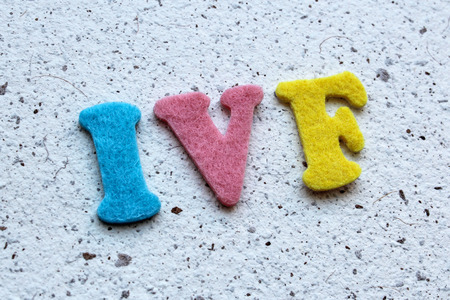 ivf: IVF (In Vitro Fertilization) acronym on handmade paper texture