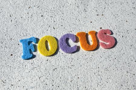 focalise: focus word on handmade paper texture