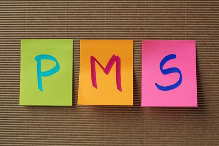 premenstrual syndrome: PMS (premenstrual syndrome) acronym on colorful sticky notes