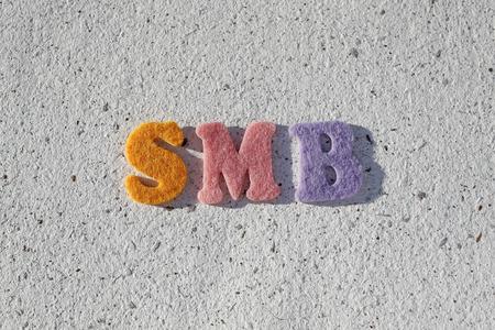 acronym: SMB (Small Medium-sized Business) acronym on handmade paper texture