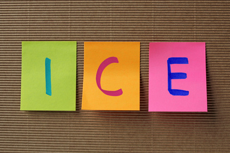 emergency case: ICE (In Case of Emergency) acronym on colorful sticky notes