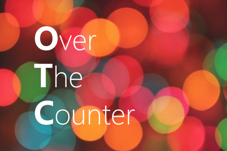 over the counter: OTC (Over The Counter) acronym on colorful background bokeh