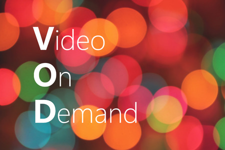 VOD (Video On Demand) acronym on colorful background bokeh