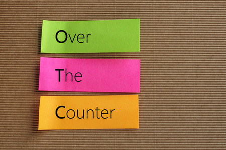 over the counter: OTC (Over The Counter) acronym on colorful sticky notes