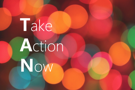 Take Action Now text on colorful background bokeh Stock Photo