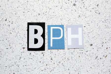 urethral: BPH (Benign Prostatic Hyperplasia) acronym cut from newspaper on white handmade paper texture Stock Photo