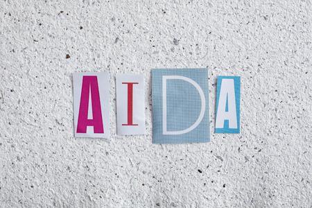 desire: AIDA (Attention Interest Desire Action) acronym on handmade paper texture