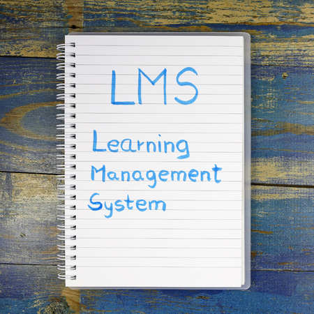 competences: LMS- Learning Management System written in notebook Stock Photo