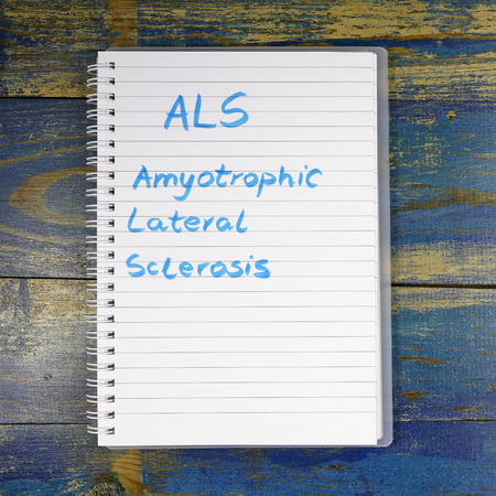 als: ALS Amyotrophic Lateral Sclerosis diagnosis written in notebook Stock Photo