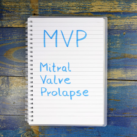 murmur: MVP- Mitral Valve Prolapse written in a notebook on wooden background