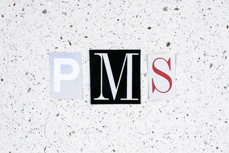 premenstrual syndrome: PMS (premenstrual syndrome) acronym on handmade paper texture