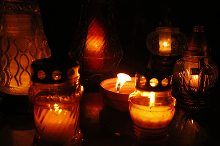 all saints day: burning candles at the cemetery on All Saints Day