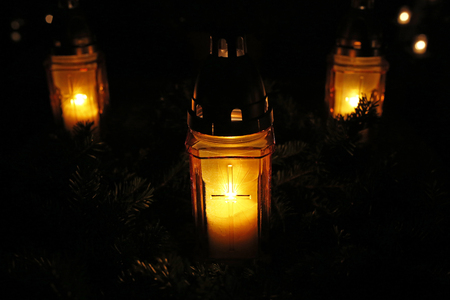 burning candles at the cemetery on All Saints Day