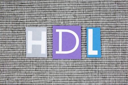 lipoprotein: HDL (high-density lipoprotein) acronym on gray background Stock Photo