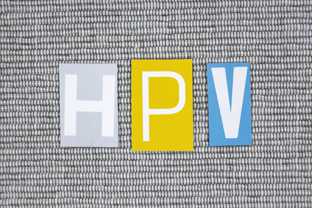 oral cancer: HPV (Human Papillomavirus) acronym on gray background