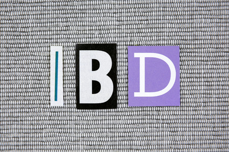 inflammatory: IBD (Inflammatory Bowel Disease) acronym on gray background Stock Photo