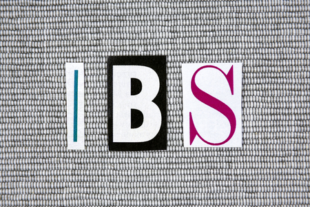 ibs: IBS (Irritable Bowel Syndrome) acronym on gray background