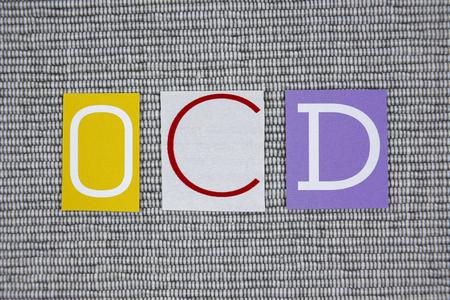 ocd: OCD (Obsessive Compulsive Disorder) acronym on gray background