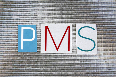 premenstrual syndrome: PMS (premenstrual syndrome) acronym on gray background
