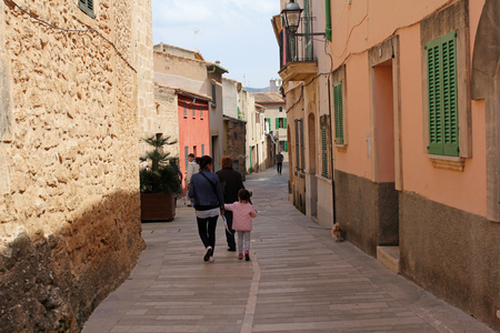 mallorca: ALCUDIA, MALLORCA, SPAIN, APRIL 4, 2016, one of the charming street in Alcudia. Its a very popular tourist destination in Mallorca, known from very well preserved the character of a historic town.