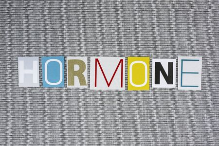 hormonal: hormone word on gray background, medical concept Stock Photo