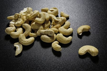 cashew nuts on black background