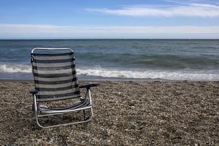 nerja: Empty sunbed on the beach