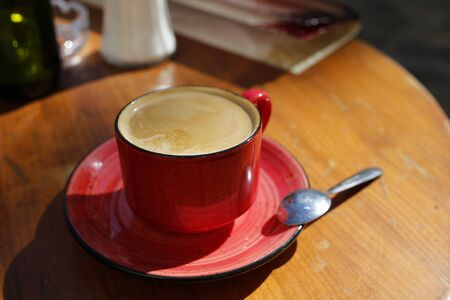 cup of coffee on the table of a sidewalk cafe Stock Photo