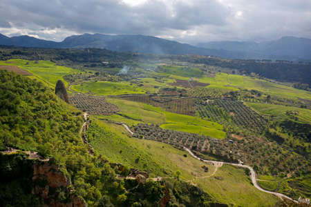 Beautiful valley landscape seen from the Puente Nuevo, Ronda, Andalusia, Spain