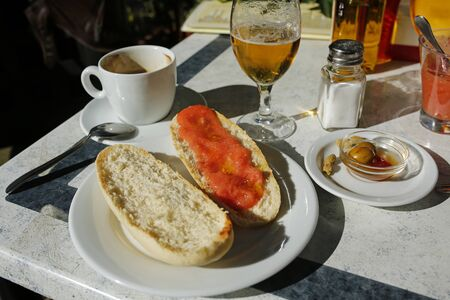 Spanish lunch- coffee, beer, olives and toast with tomatos and olive oil