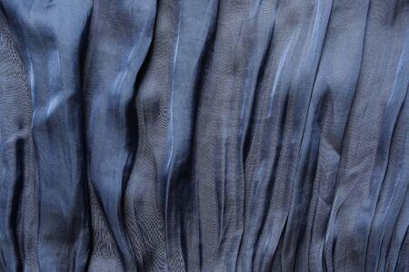 Blue wave shiny satin fabric background