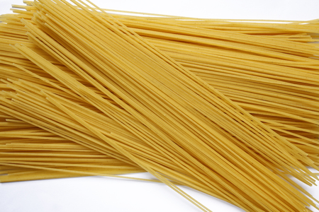 Spaghetti pasta on white background