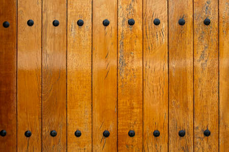 Wooden panels with metal nits
